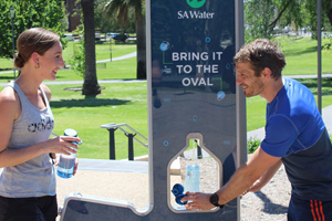 SA Water drinking fountain being used by two runners